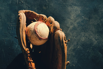 Baseball in old leather glove, shows ball and mitt for sports equipment with copy space. Wall mural