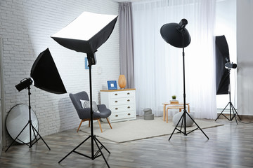 Example of living room interior design and professional equipment in photo studio