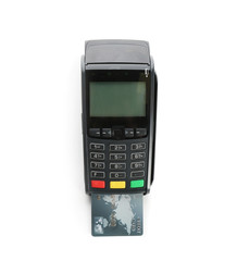 Modern payment terminal with credit card on white background, top view. Space for text
