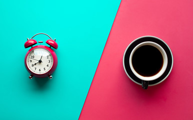 Refreshment concepts with coffee cup and alarm clock