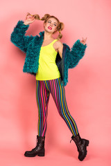 Minimal fashion Pop Art girl. Vanilla pastel pink colors. Girl in a fur coat