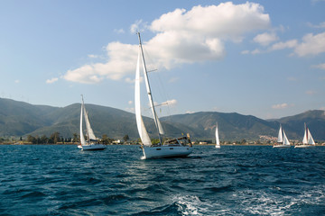 Yachts at Sailing regatta. Sailing in the wind through the waves at the Sea.