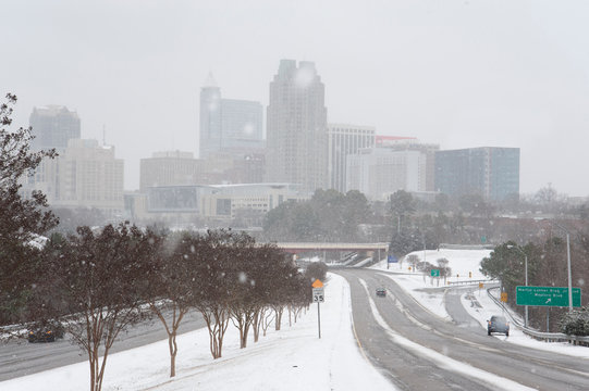 A heavy winter storm dumps inches of snow in downtown Raleigh.