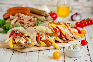 Assorted tortilla wraps with meat, sausages, cheese