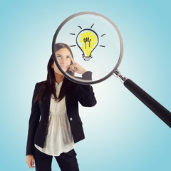 Wall Mural - Magnifying glass examines the idea of a young businesswoman