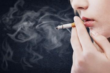 Portrait of the beautiful elegant girl smoking cigarette