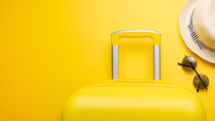 The flat lay a yellow suitcase with accessories for relaxing on a yellow background. concept of travel, rest and relaxation. Banner for advertising