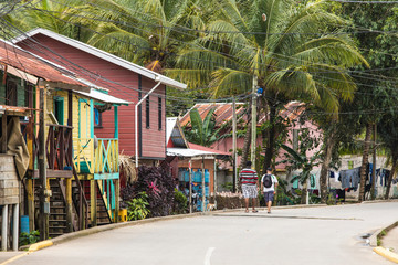 People walk down the streets of the Garifuna village of Punta Gorda, Honduras. Fototapete
