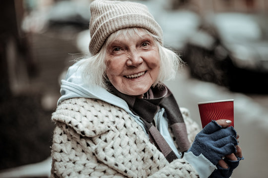 Portrait of a cheerful nice aged woman