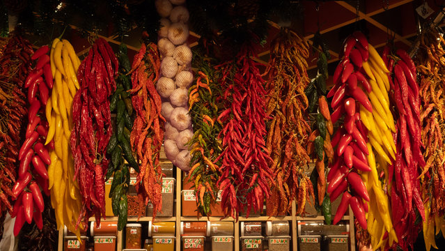 Red and green peppers garlic spices dry in the La Boqueria market Barcelona