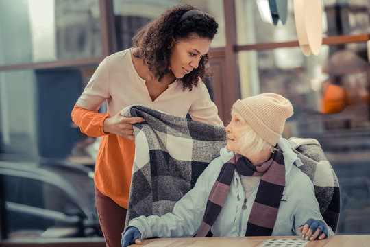 Pleasant kind woman taking care of her guest