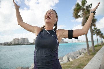 Energetic sporty woman smiling outdoors in sportswear