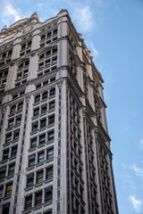 Perspective view to facade fragment of an old building in midtown Manhattan