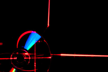 abstraction DVD drive in the light of the red laser light black