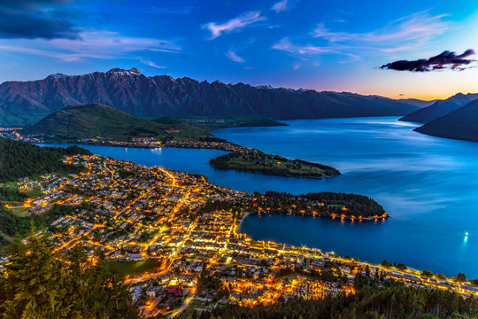 New Zealand. South Island, Otago region. Queenstown and Lake Wakatipu by night, the Remarkables mountain range behind