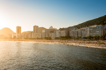 Wall Mural - Warm Sunset in Copacabana, the Famous Beach of Rio de Janeiro City, Brazil