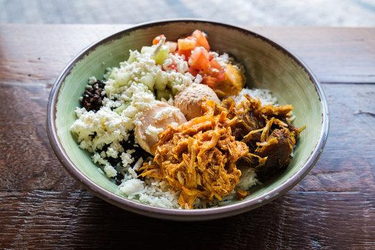 Mediterranean style dinner bowl with chicken, black lentils and white jasmine rice.