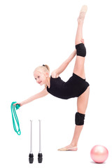 Beautiful teen girl doing rhythmic gymnastics exercises. White background