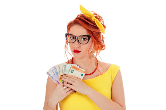 Greedy woman holding money, euro cash refusing to give it.