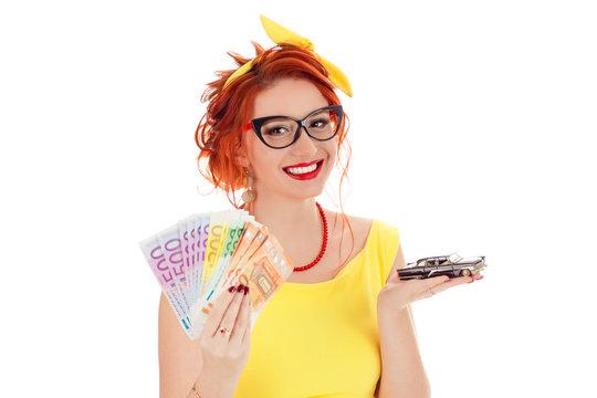 woman holding model black car, Euro money cash bills in hand