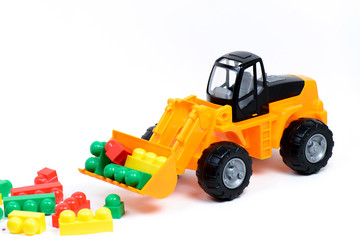 Colored toys for children on a white background