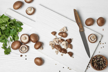 Flat lay composition with fresh champignon mushrooms on wooden table