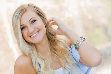 High School Senior Photo of Blonde Caucasian Girl Outdoors