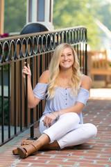 High School Senior Photo of Blonde Caucasian Girl Outdoors