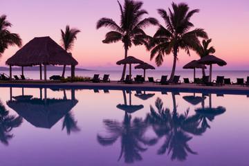 Pinkish purple sunrise colors reflecting in the water in Fiji