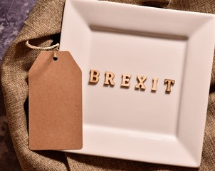 Word brexit on white plate with price lable - tag.