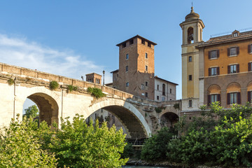 Cityscape with Castello Caetani, Tiber River and Pons Fabricius in city of Rome, Italy