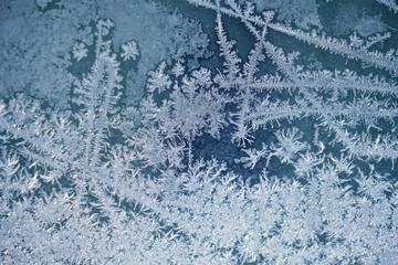 frost crystal on window glass in winter season