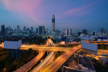 Panoramic Bangkok city building modern business district with expressway in downtown at twilight in Bangkok, Thailand..