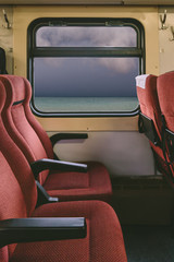 Seats and windows with sea view in train