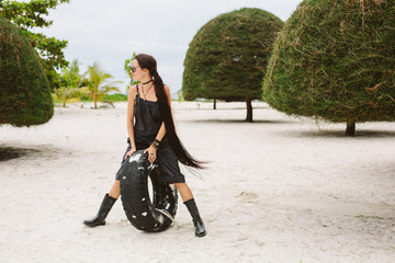 Beautiful style girl walking on tropical beach
