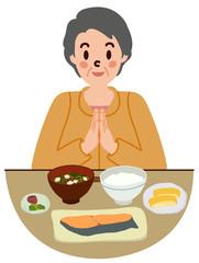 食前の挨拶をするシニア女性