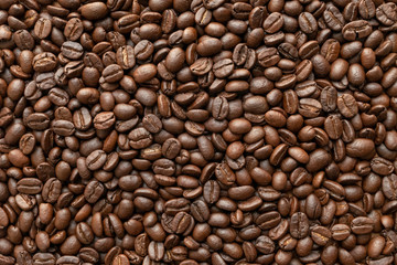 Roasted of coffee beans for background. Close-up.