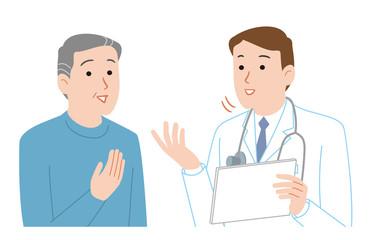 医者と会話する高齢者