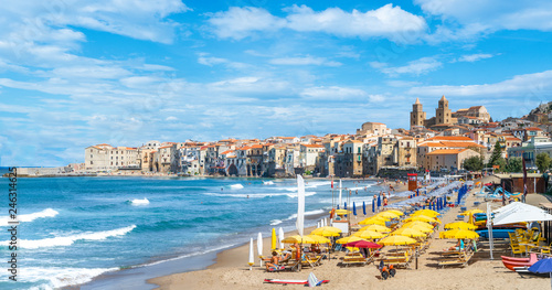 Wall mural Cefalu, Sicily - September  24, 2018: Landscape with beach and medieval Cefalu town, Sicily island, Italy