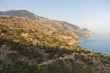 Viewpoint on a hiking trail near Lissos gorge to a coastline above Sougia bay at sunset, south-west coast of Crete island, Greece