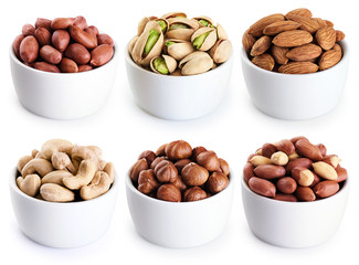 Bowl with pistachios, hazelnut, peanuts, almonds, cashews isolated on white background.