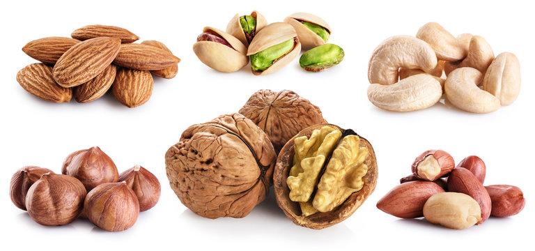 Walnut, pistachios, hazelnut, peanuts, almonds, cashews isolated on white background.