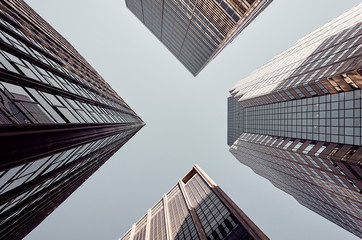 Looking up at New York skyscrapers, color toned picture, USA.