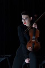 Foto op Canvas Muziek violin and girl playing, cello on dark background, red lips, brunette
