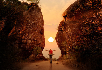 Foto op Plexiglas Rood paars Woman standing and open hand on sunset or sunrise background