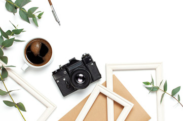 Photo frame old retro camera notebook diary cup of coffee pens eucalyptus leaves on white background. Flat lay top view copy space. Stylish minimal composition artwork mockup Feminine desk workspace