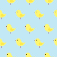 Vector seamless pattern with cute yellow Easter chickens on a blue background. kawaii