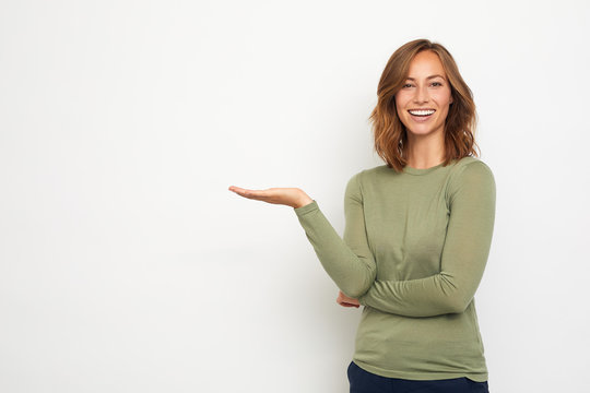 young happy woman presenting your product on thie background