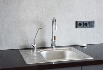 Modern metal kitchen sink. Modern kitchen chrome faucet and metal kitchen sink. Fototapete