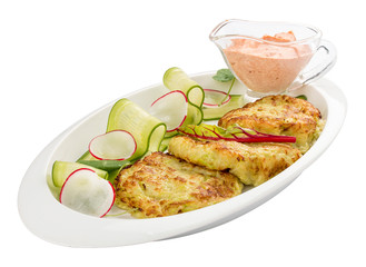 Zucchini pancakes with sauce on a white plate
